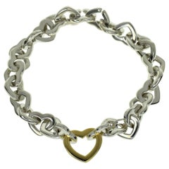 Tiffany & Co. 925 Sterling Silver 18 Karat Yellow Gold Heart Link Bracelet