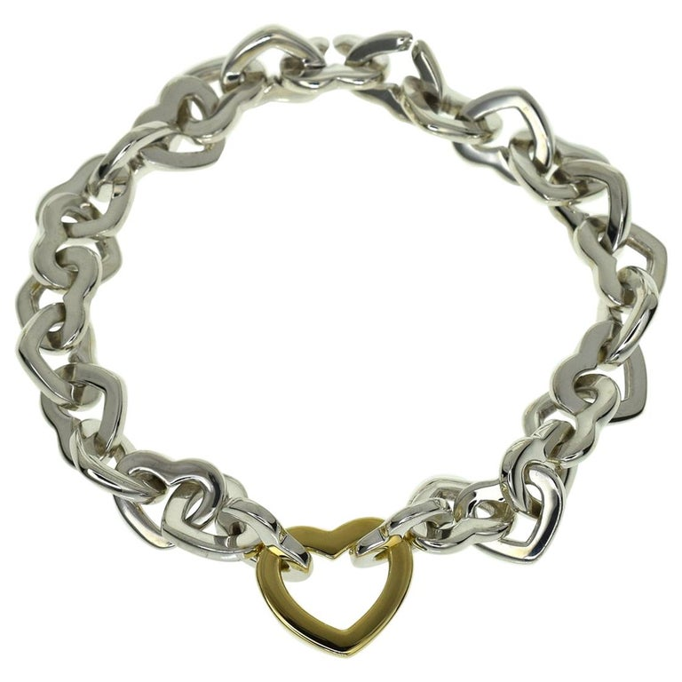 e307e5c32 Tiffany & Co. 925 Sterling Silver 18 Karat Yellow Gold Heart Link Bracelet  For Sale