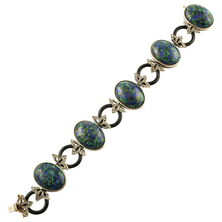 Malachite Ovals, Onyx Rings, Diamonds, 9 Karat Rose Gold and Silver Bracelet For Sale