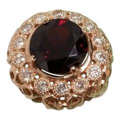 14 Karat Rose Gold Garnet and Diamond Domed Ring