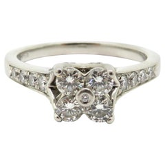 Estate Platinum Flower Round Diamond Engagement Ring