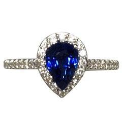 Ceylon Pear Cut Blue Sapphire and Diamond 18 Karat White Gold Halo Ring