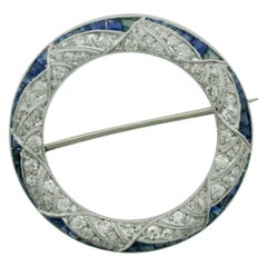 1920s Art Deco Diamond and Sapphire Circle Brooch in Platinum