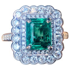 Emerald and White Round Brilliant Cut Diamond Double Halo Cocktail Ring
