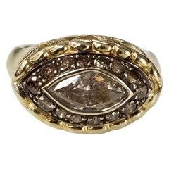 14 Karat Yellow Gold Brown Diamond Halo Ring Containing 1 Marquise Cut Diamond