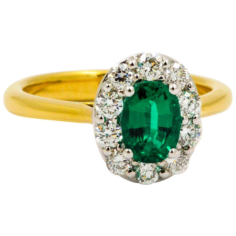 18 Karat Yellow Gold Emerald and Diamond Halo Engagement Ring For Sale