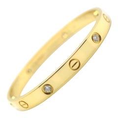 Cartier Love Bracelet 18 Karat Yellow Gold with 4 Diamonds