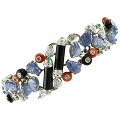 Diamonds, Sapphires, Emeralds, Onyx, Coral, 14 Karat White Gold Fantasy Bracelet