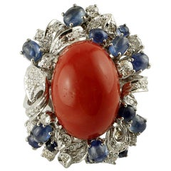 Big Central Red Coral, Diamonds, Blue Sapphires 14 Karat White Gold Ring
