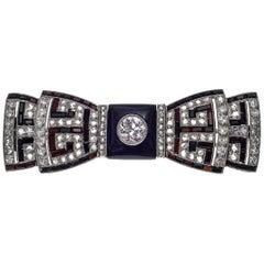 Art Deco Bow Diamond Onyx Platinum Brooch