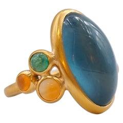Scrives 13.5 Carat Aquamarine Emerald Cornaline Cabochons 22 Karat Gold Ring