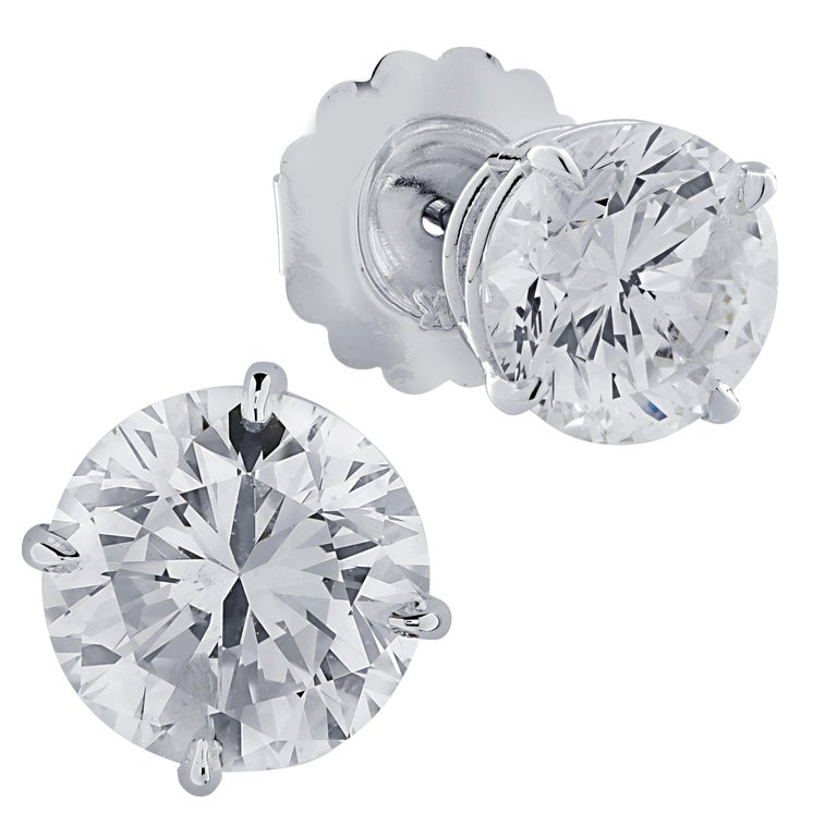 Stunning solitaire stud earrings crafted in 18 karat white gold, showcasing 2 round brilliant cut diamonds weighing 5.83 carats total, M color I1 clarity. These gorgeous earrings are classic and timelessly elegant.  Our pieces are all accompanied by
