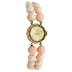 Coral Peau D'ange Baume and Mercier 14 Karat Gold Watch