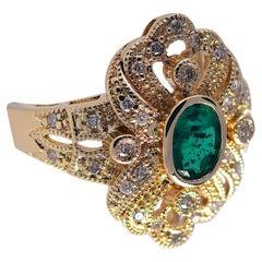 Ornate .52 Carat Emerald and .21 Carat Diamond Fashion Ring. 14 Karat Gold