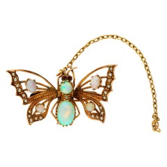 Antique 9 Carat Yellow Gold Opal and Split Pearl Butterfly Brooch