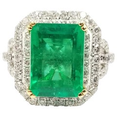 4.70 Carat Emerald Cocktail Ring with Double Diamond Halo