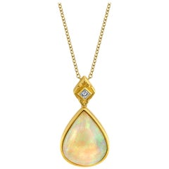 6.83 Carat Pear Shape Opal and Diamond 18 Karat Yellow Gold Pendant