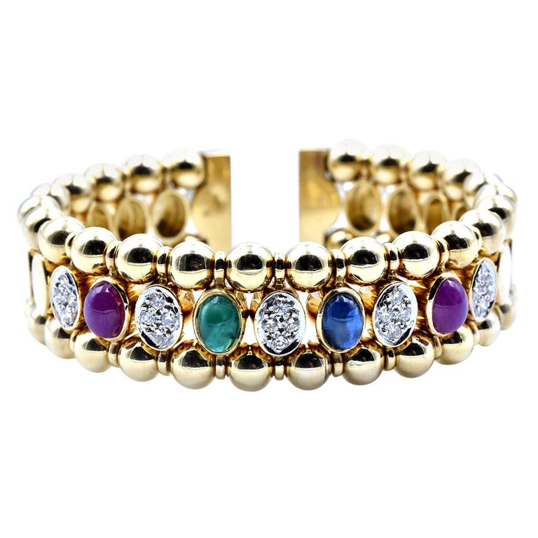 18 Karat Yellow Gold Cabochon Ruby, Sapphire and Emerald Bangle Bracelet For Sale