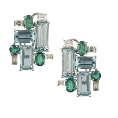 Set in 18k white gold, Aquamarine, Emerald and Baguette Diamonds stud Earrings