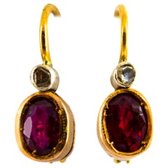 1.00 Carat Ruby 0.04 Carat White Diamond Yellow Gold Dangle Lever-Back Earrings