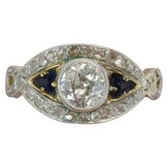 Art Deco 1.00 Carat Old Cut Diamond and Sapphire 18 Carat Gold and Platinum Ring