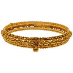 22 Karat Yellow Gold Bangle Bracelet Ruby Accents