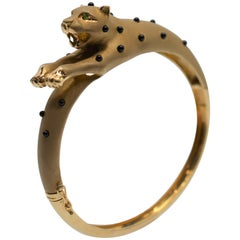 14 Karat Yellow Gold Panther Bangle Bracelet with Onyx Spots and Emerald Eyes