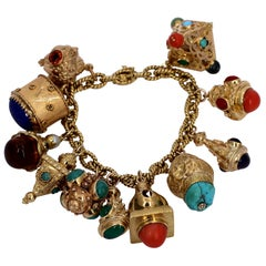 Gold Charm Bracelet with Eleven Charms with Assorted Stones