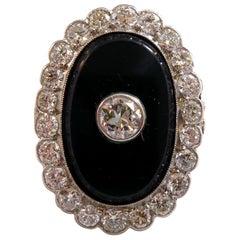 Art Deco 1.37 Carat Diamond and Onyx Ring, Oval Cluster, 1920, Platinum