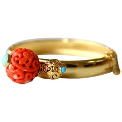 Antique Chinese Carved Coral Bead on a Gold Bangle
