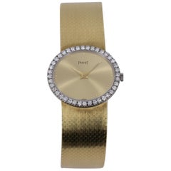 Ladies Gold Piaget Watch with Champagne Dial and Diamond Bezel