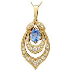 1980s 1.10 Carat Aquamarine Diamond Yellow Gold Pendant