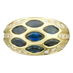 "Darling Sapphire and Diamond Ring in 18 Karat Signed ""Riviere & Cie."""