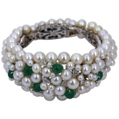 Midcentury White Gold Bracelet with Diamonds Emeralds and Pearls