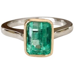 Estate Solitaire Emerald 18 Karat Platinum Ring