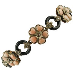 Coral, Onyx, Rubies, Diamonds, 9 Karat Rose Gold and Silver, Flowery Bracelet