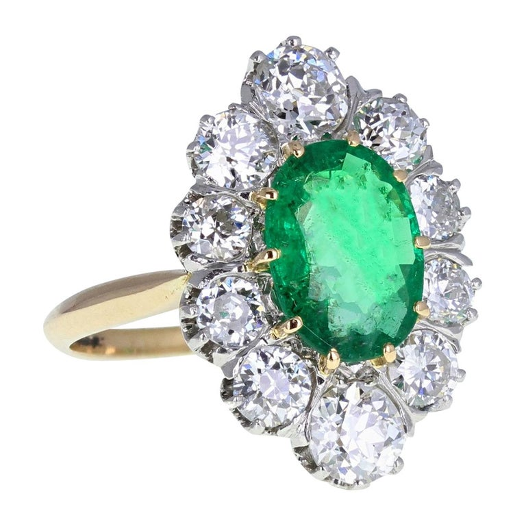 Antique 18 Carat Gold Platinum Oval Emerald Diamond Navette Cluster Ring For Sale