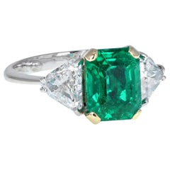 Emerald Trilliant Cut Diamond Three-Stone Platinum Ring