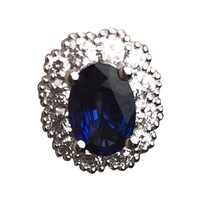 1.67 Carat Oval Cut Blue Sapphire Earrings with Diamond Halo in 18k White Gold For Sale