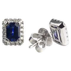1.22 Carat Emerald Cut Blue Sapphire Earrings with Diamond Halo