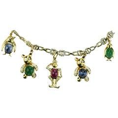 Adler Charm Bracelet with Penguins, Bear, Devil Eye in Diamond, Ruby & Emerald