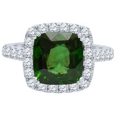 5.42 Carat Cushion Cut Green Zircon Ring with 0.52 Carat Total Diamond Halo