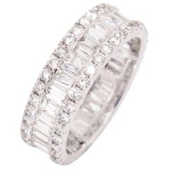 14 Karat Gold VS2,G,2.79 Carat Baguette Diamond with Diamond Sides Eternity Band
