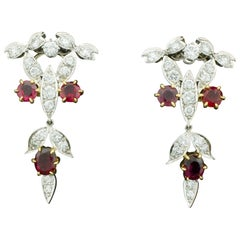 Dramatic Ruby and Diamond Dangling Earrings circa 1940s in Platinum and 18 Karat