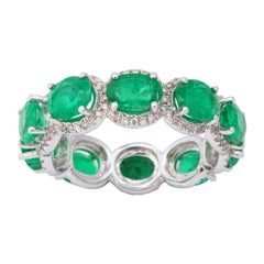 Oval Emerald and Diamond Halo Eternity Band Ring