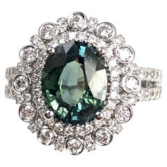 2.60 Carat Oval Cut Green Sapphire and 1.03 Carat Diamond Ring in 18 Karat Gold