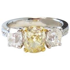 GIA Fancy Yellow Diamond Cushion and White Diamond 3 Stone Ring in 18k Gold
