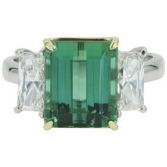 Very fine green Tourmaline in a Platinum & 18kt YG mounting w 2 side diamonds