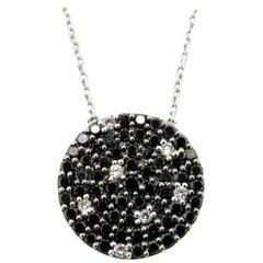 Estate 18 Karat White Gold Black and White Diamond Pave Circle Pendant Necklace