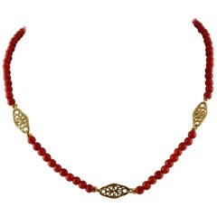 Beaded Coral Necklace and 18 Karat Yellow Gold Decorations